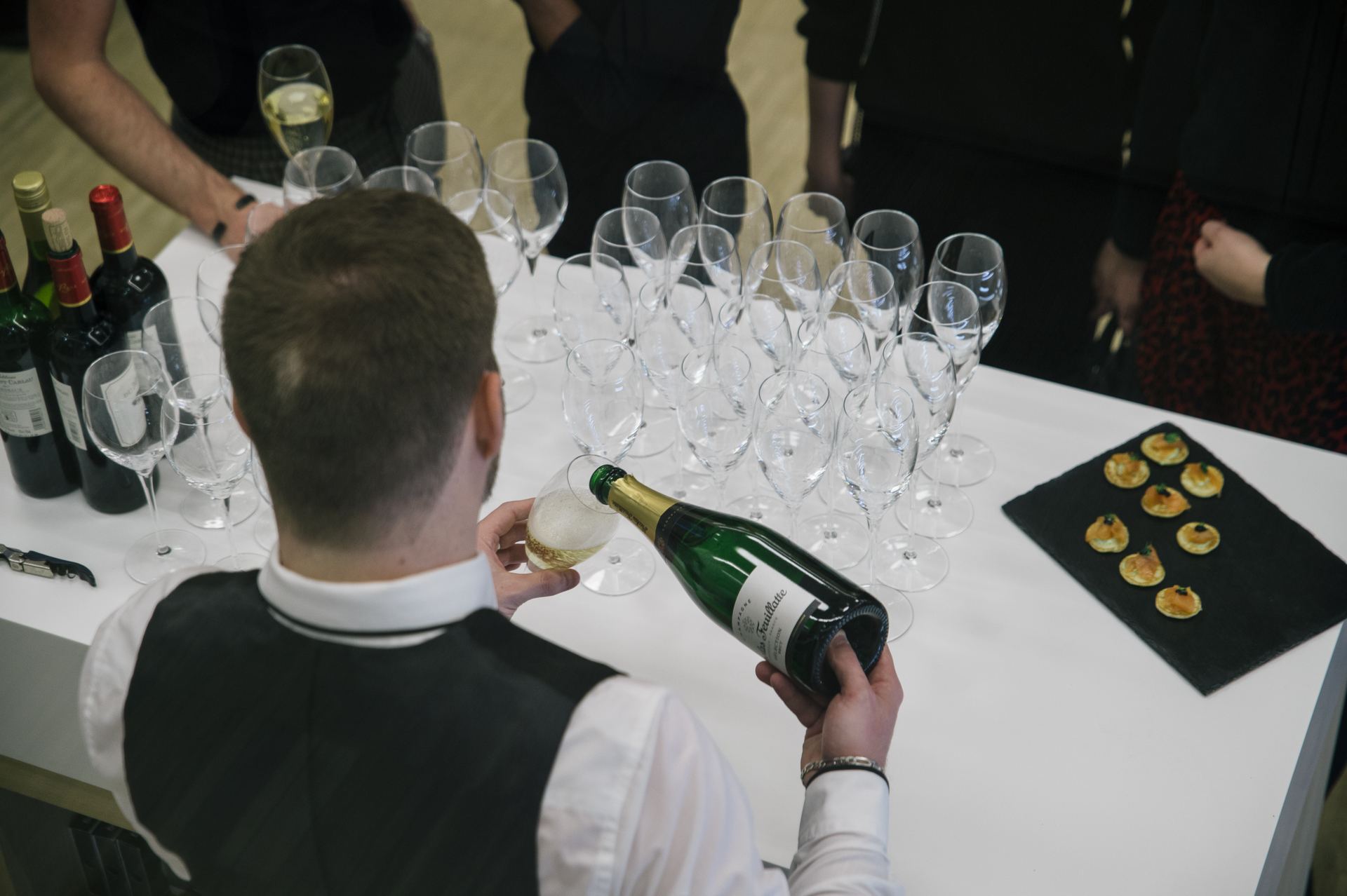 waiter pouring champagne in a glass