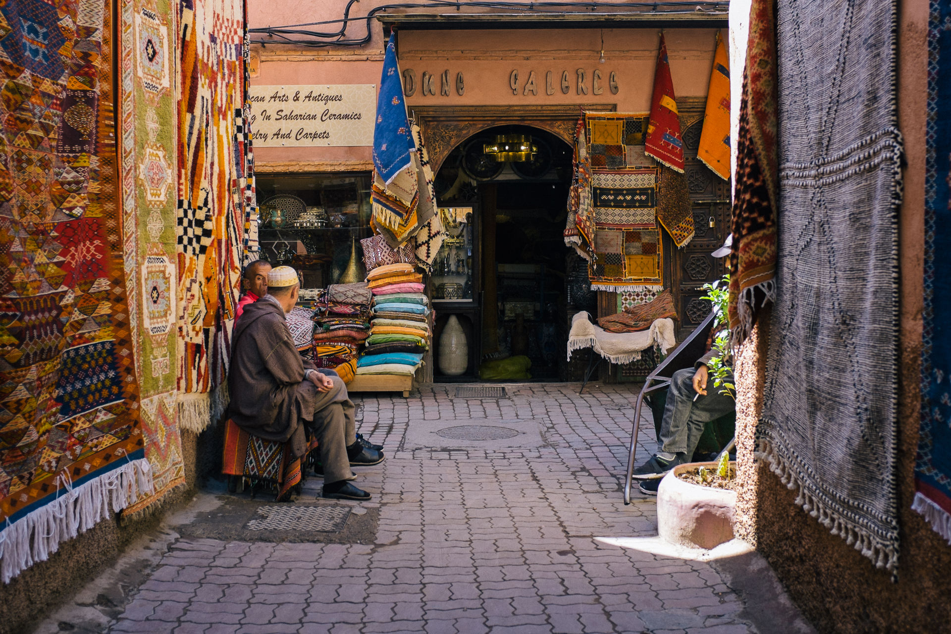 street in Marrakesh full of rugs for sale