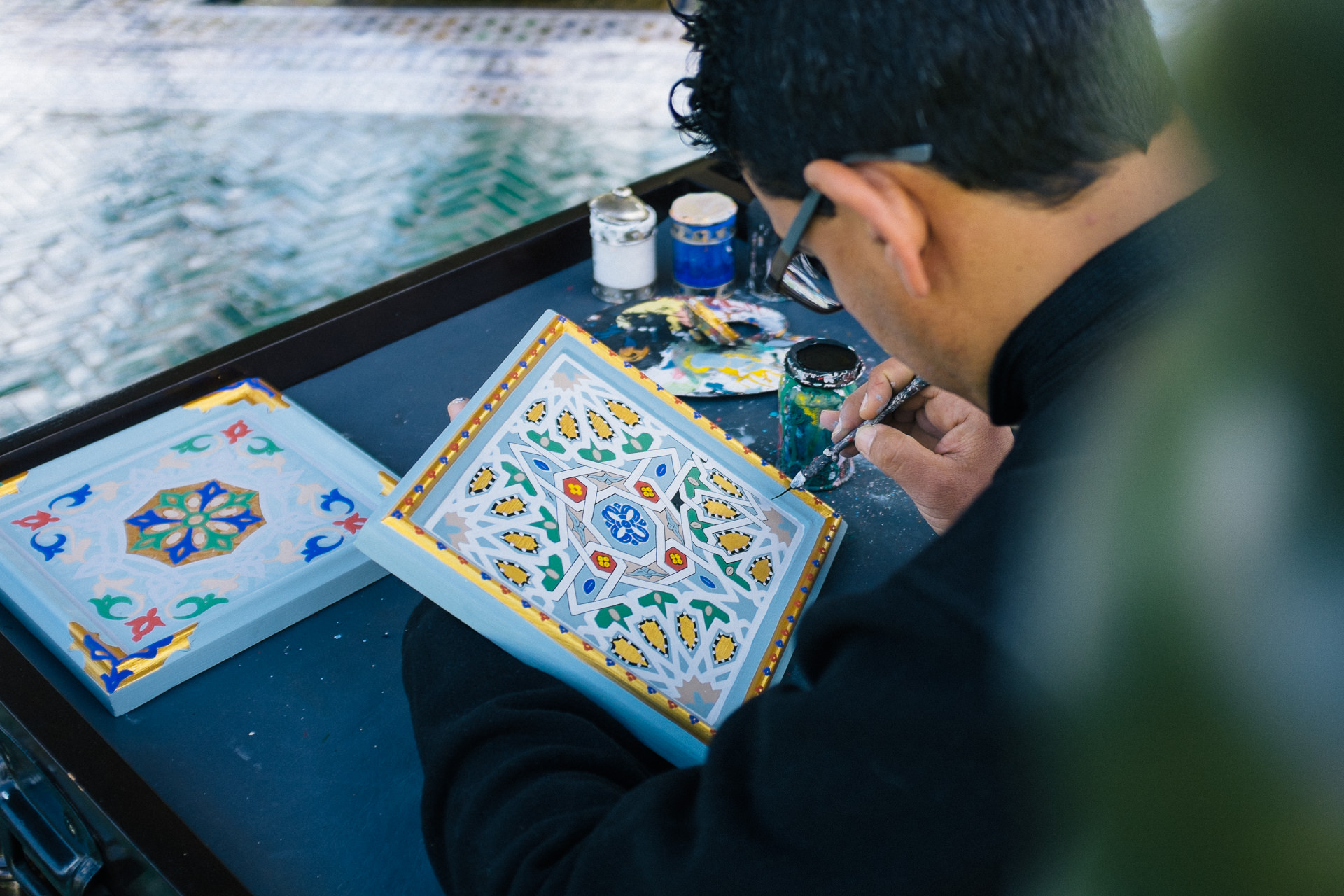 Local artist painting tiles in Marrakesh