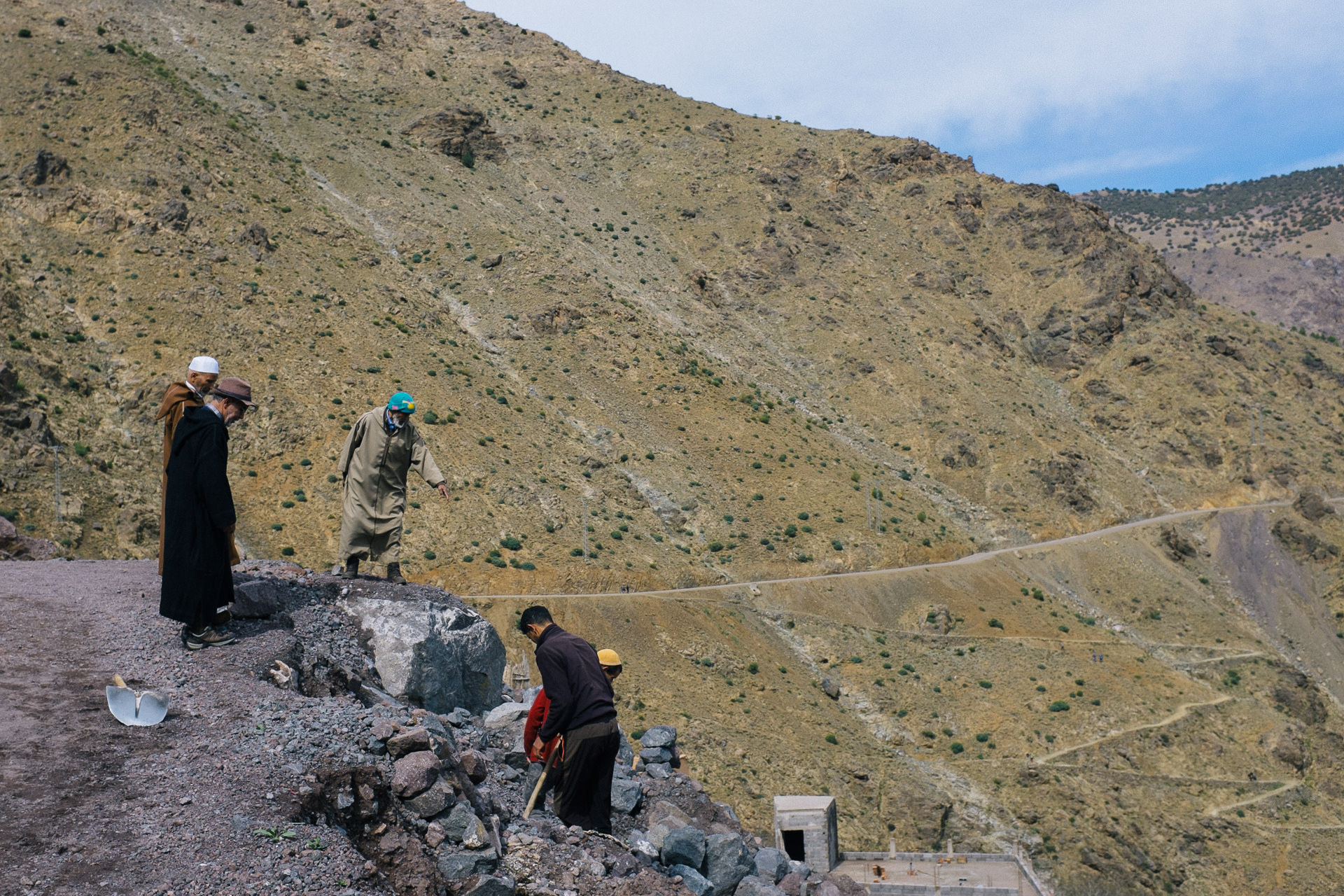 Berbers workers repairing a road high in the Atlas mountains