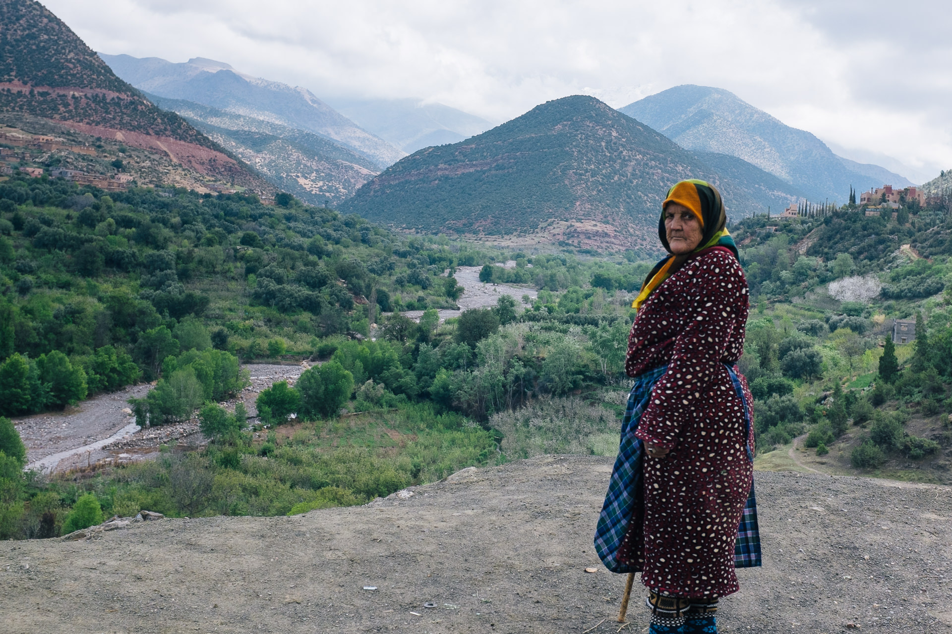 Berbers woman looking at the camera with the high atlas mountains in the background