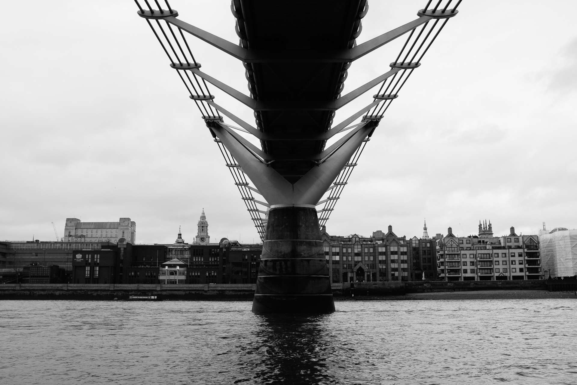 millenium bridge London from the level of water during a low tide