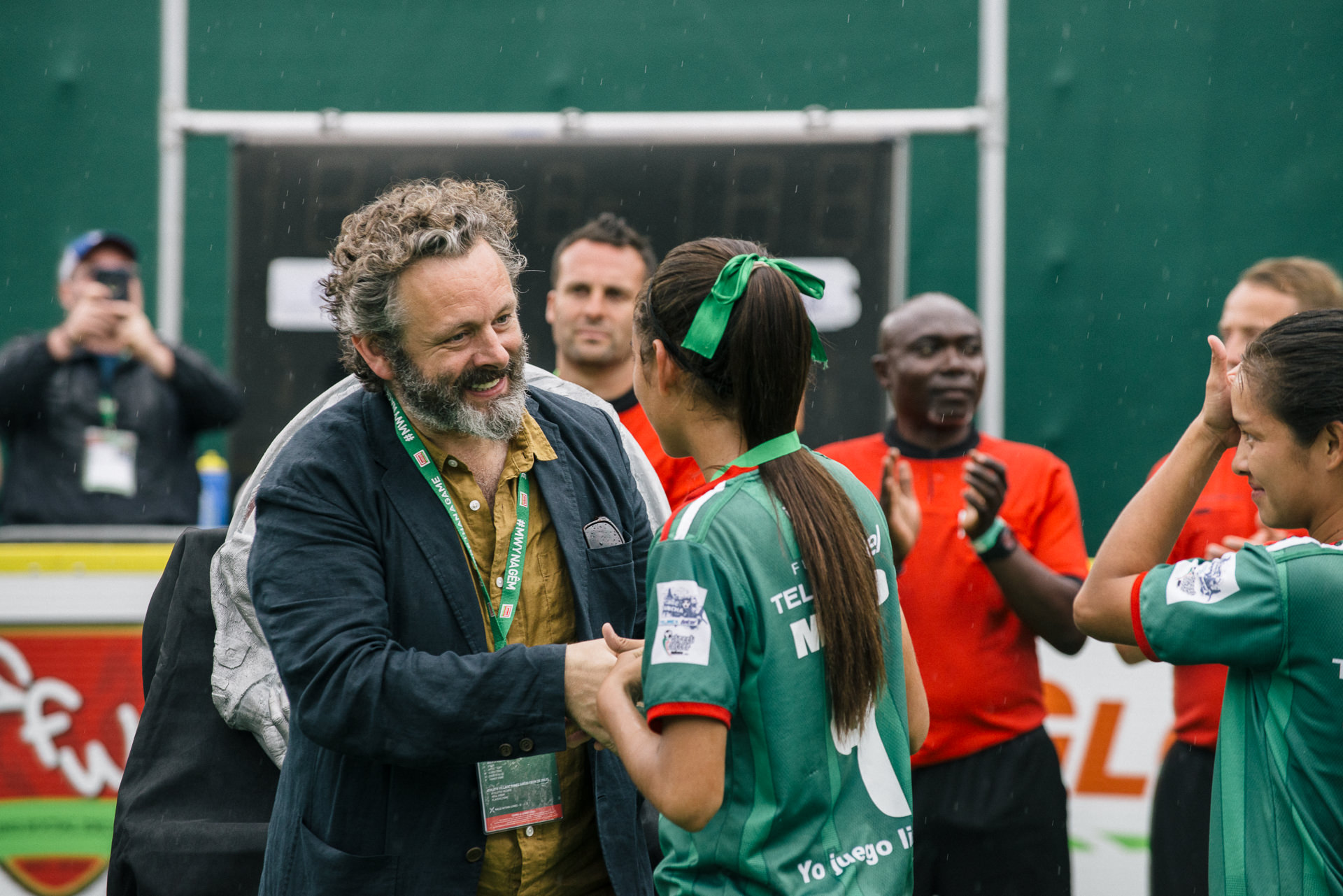 Michael Sheen handing the cardiff2019hwc medals