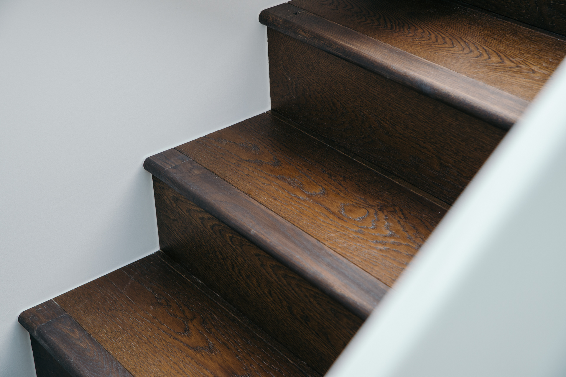brown wooden stairs closeup image