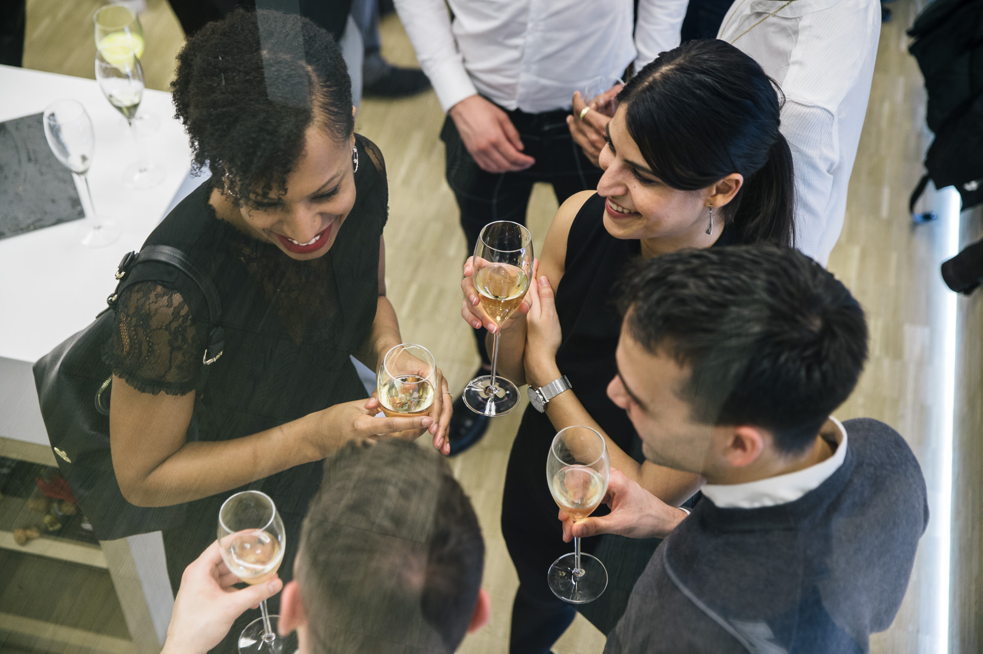 4 people having a champagne during an event