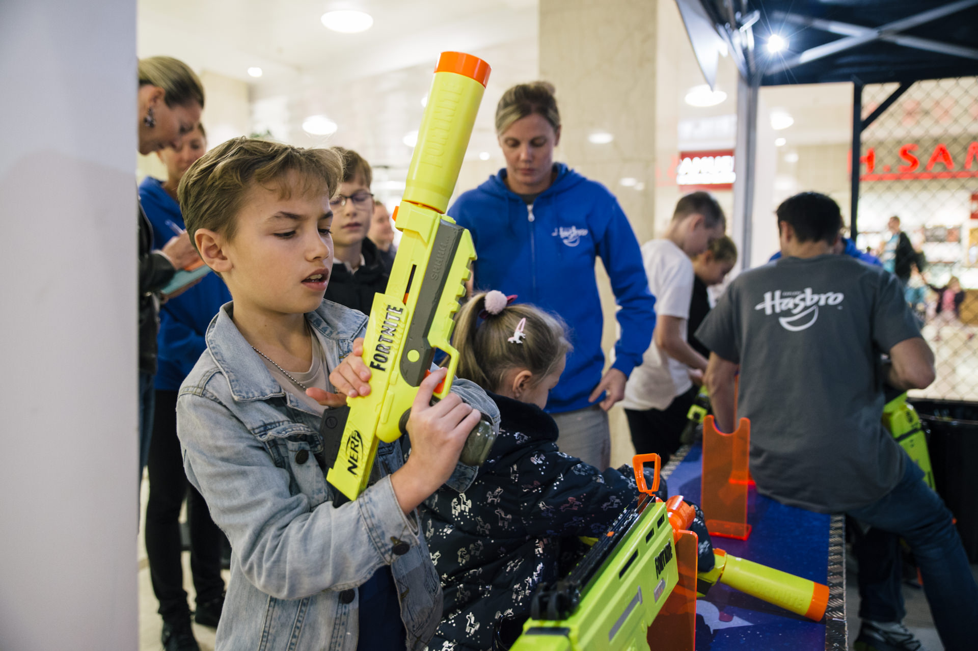 a kid loading nerf toy gun