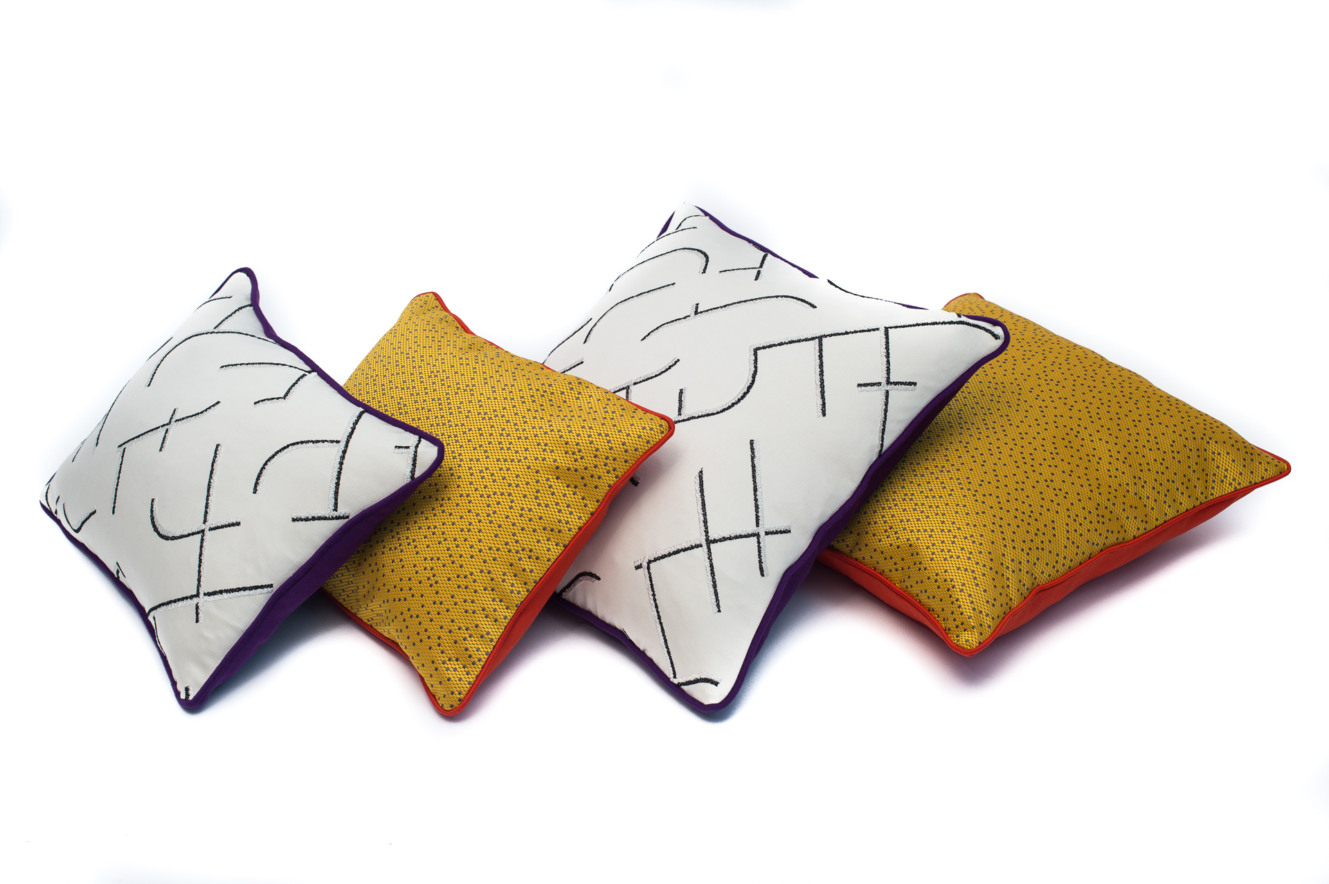 four custom made pillows on the white background