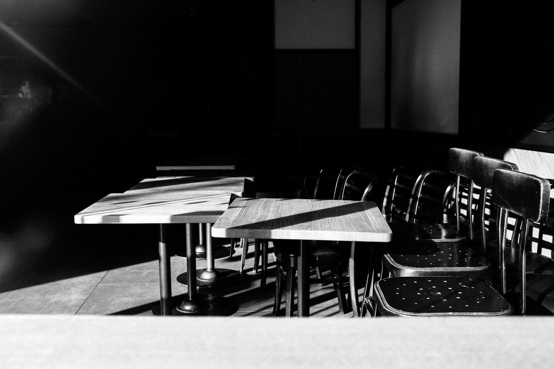 black and white empty tables in a coffee shop