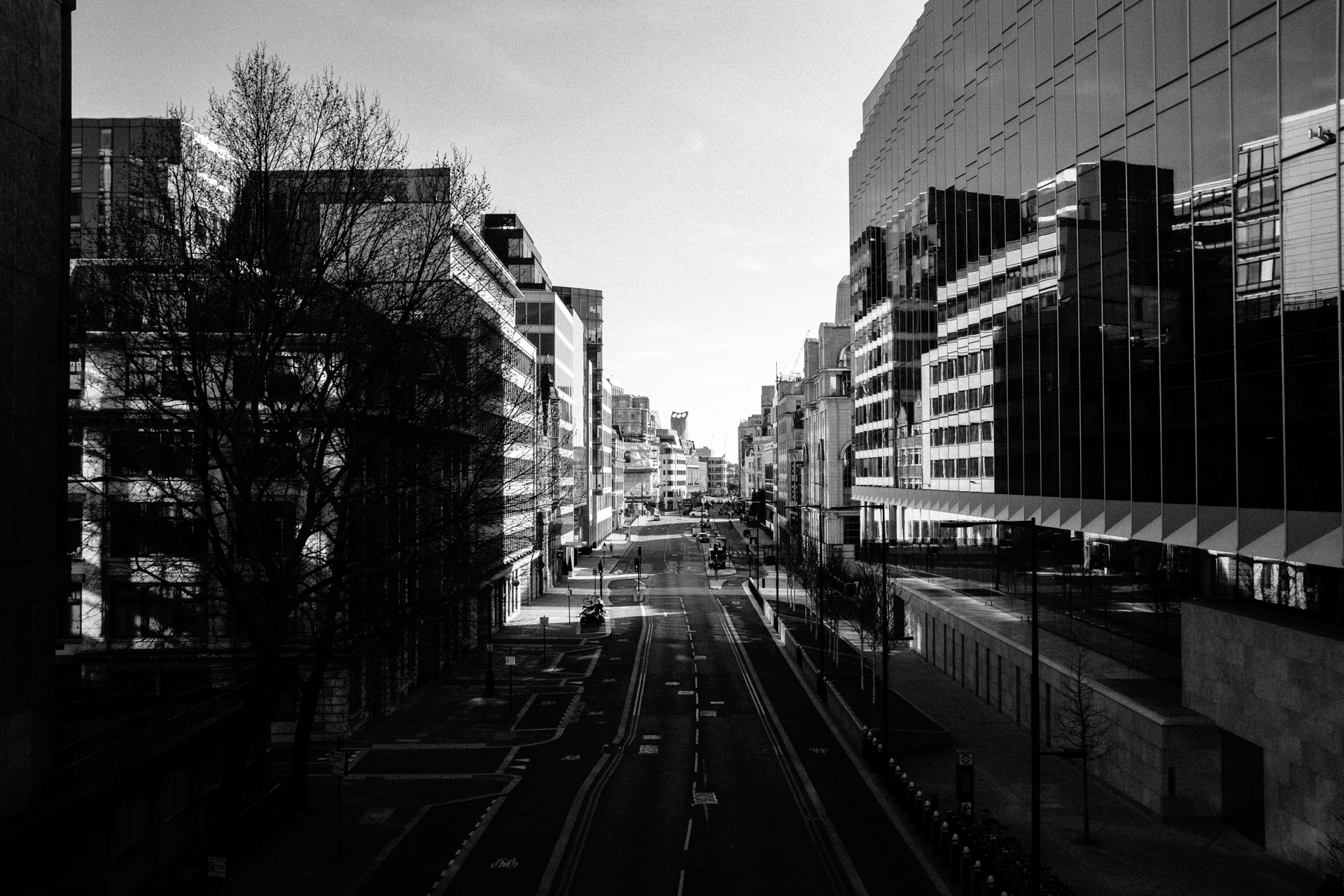 view on empty farringdon street from holdborn viaduct in central london