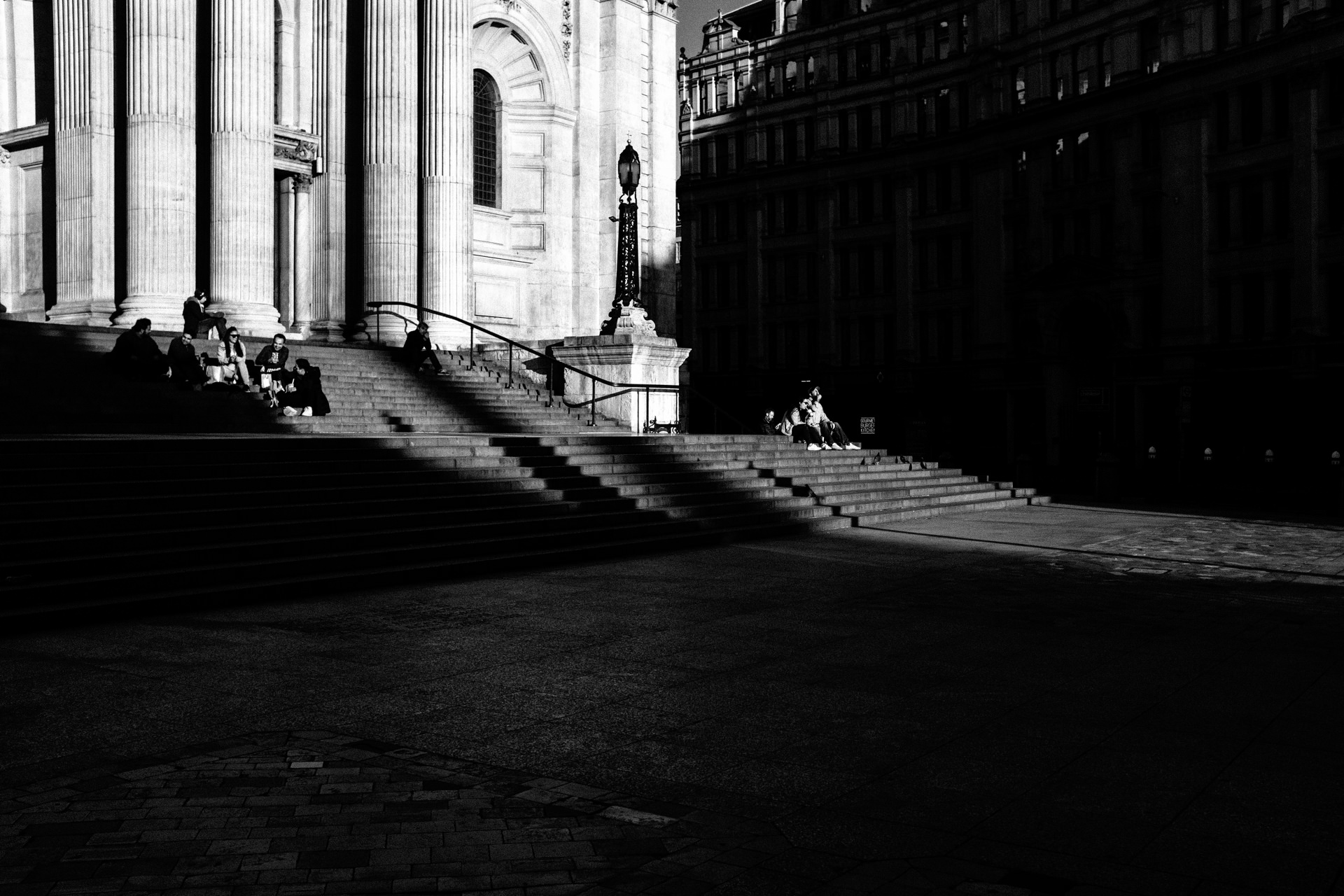 people on front of St Pauls cathedral in London