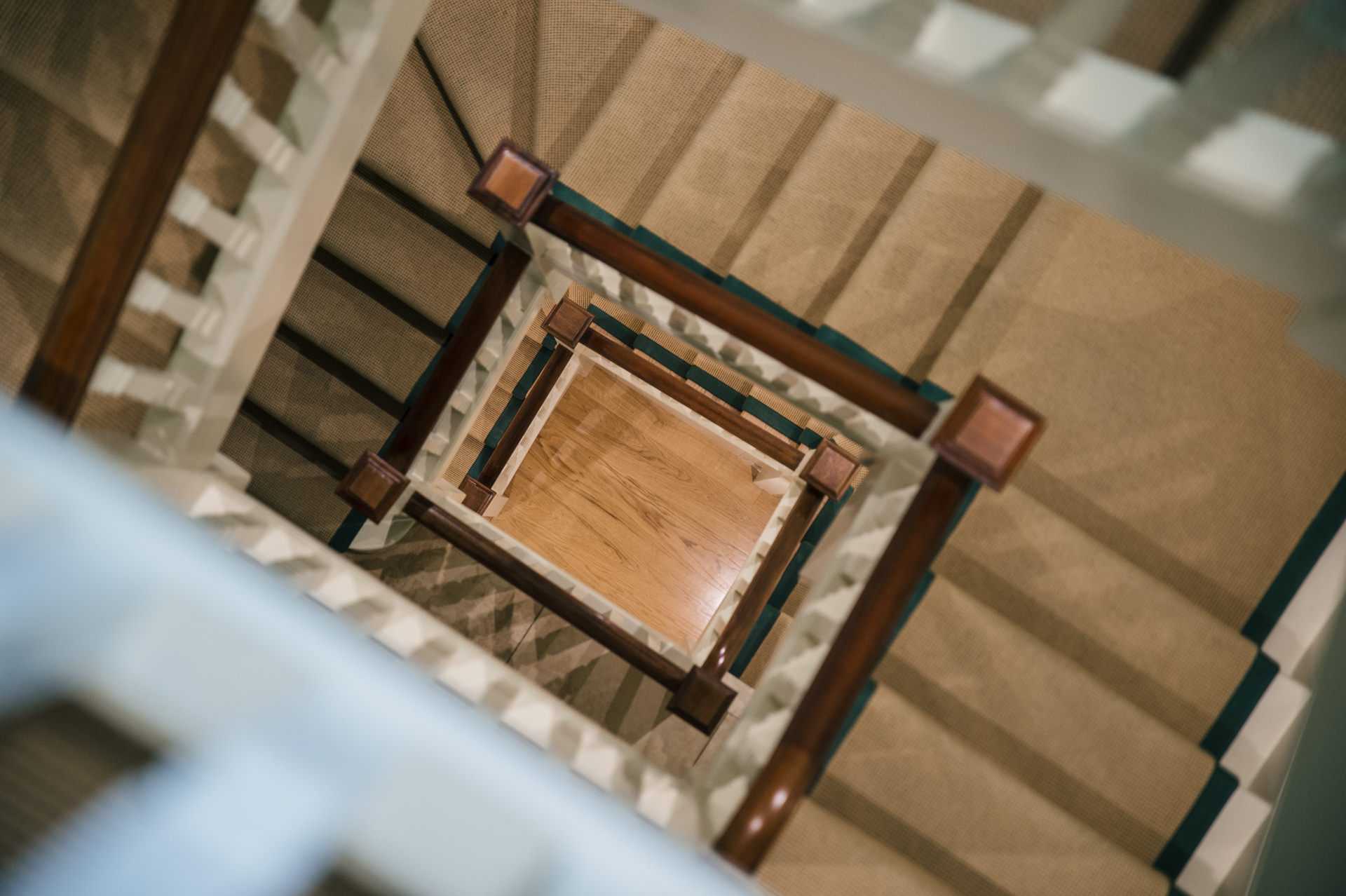 wooden square staircase view from the top