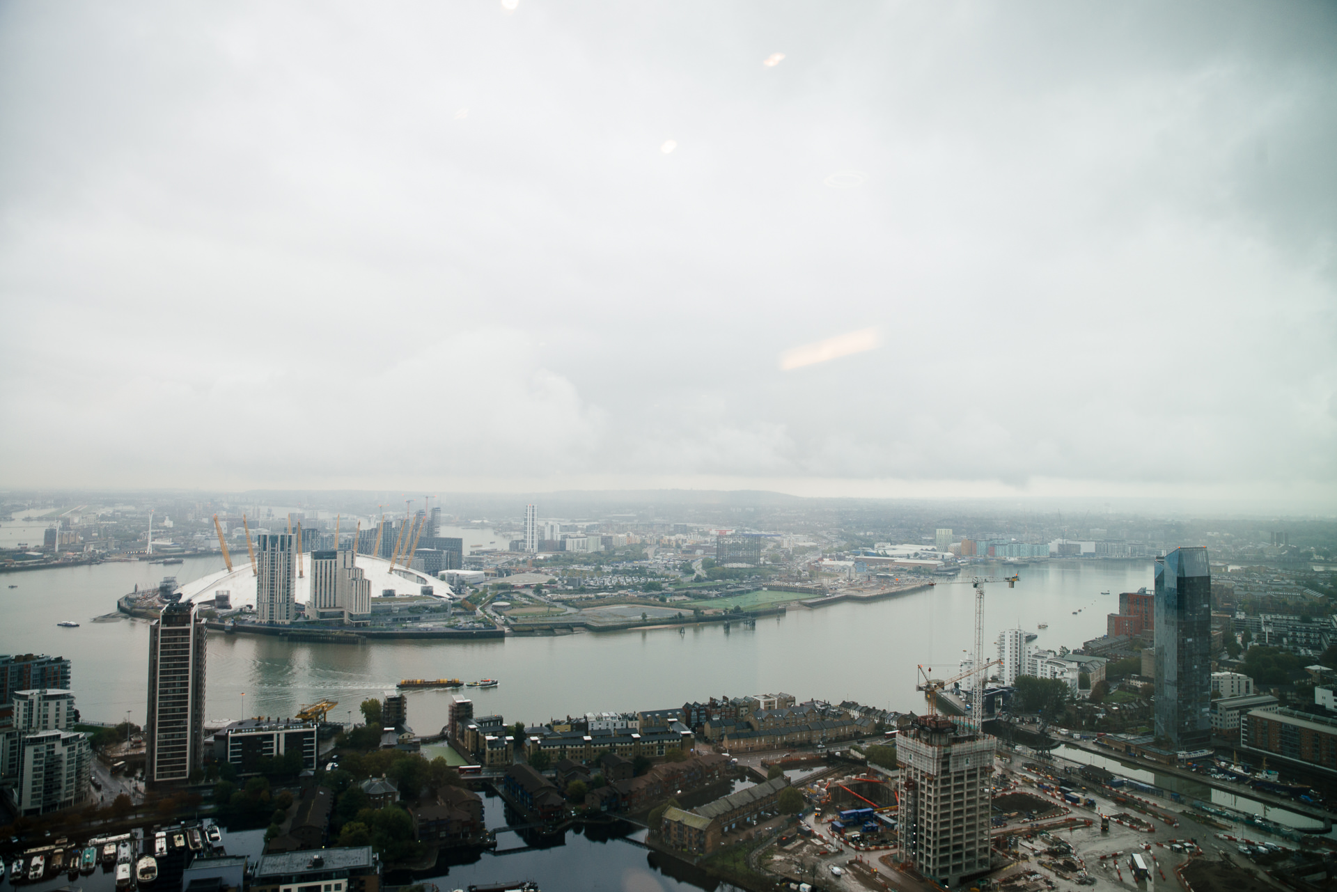 view over o2 london from canary wharf skyscrapper
