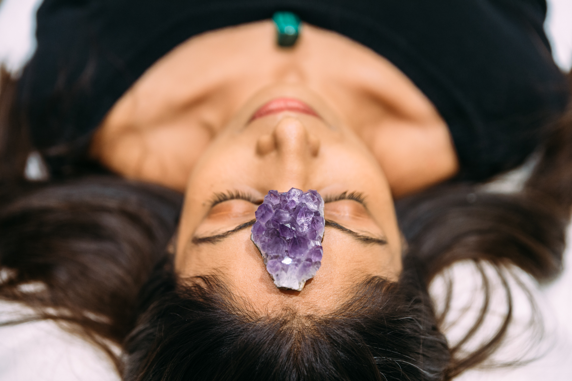 healing stone on a woman head